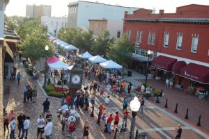 Things to do in Orlando: image of downtown street with vendors during Alive After 5 in Sanford.