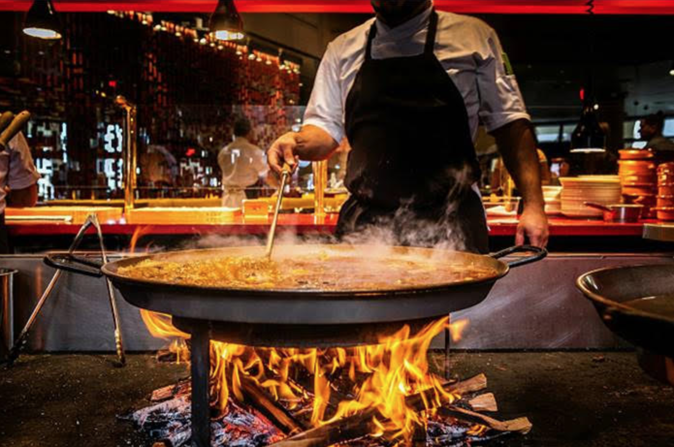 Things to do Orlando: image of chef cooking a dish at Jaleo during Orlando Magical Dining