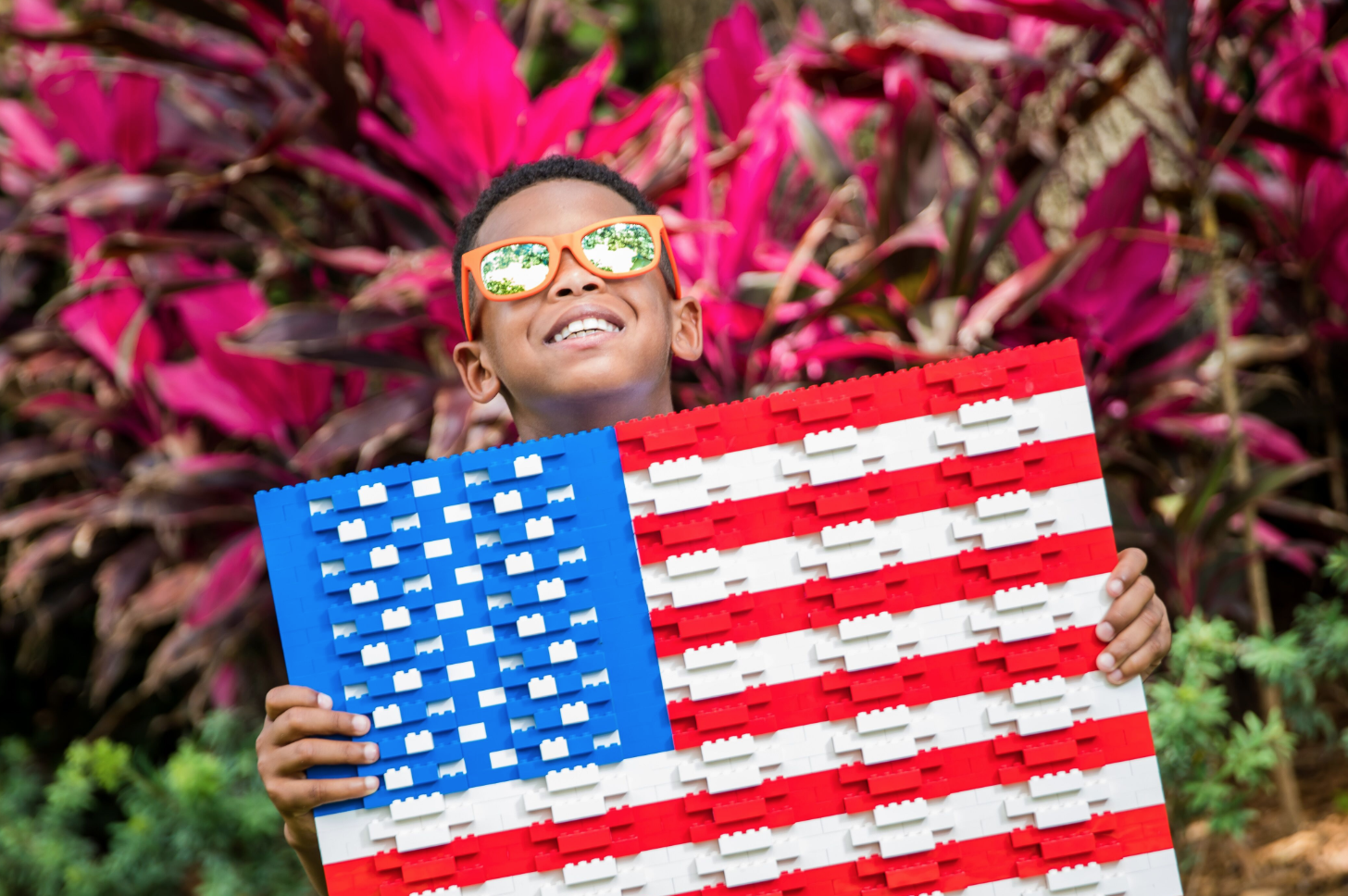 Veterans discounts LEGOLAND Florida: image of child holding American Flag made out of LEGOS