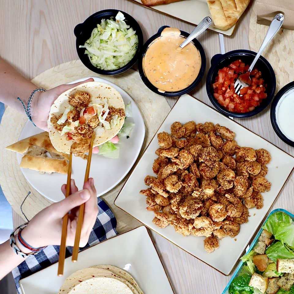 Family meal bundle deals Orlando: image of a family sized spread with Bang Bang tacos by Bonefish Grill