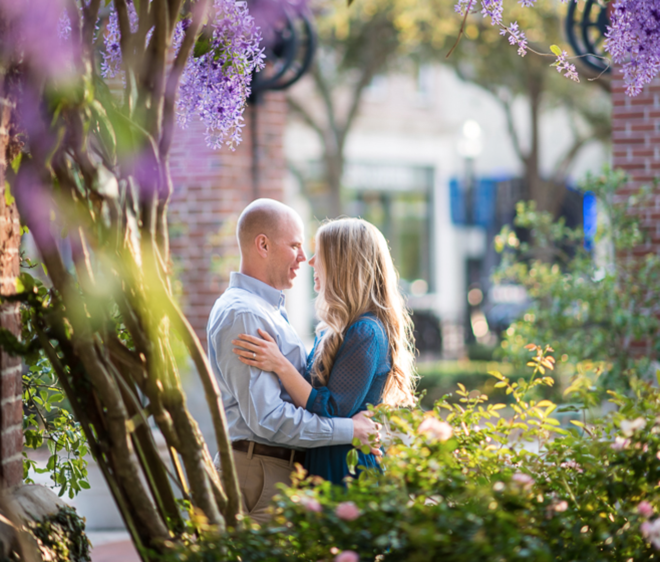Date night ideas in Winter Garden: image of a couple hugging in historic downtown Winter Garden near Orlando