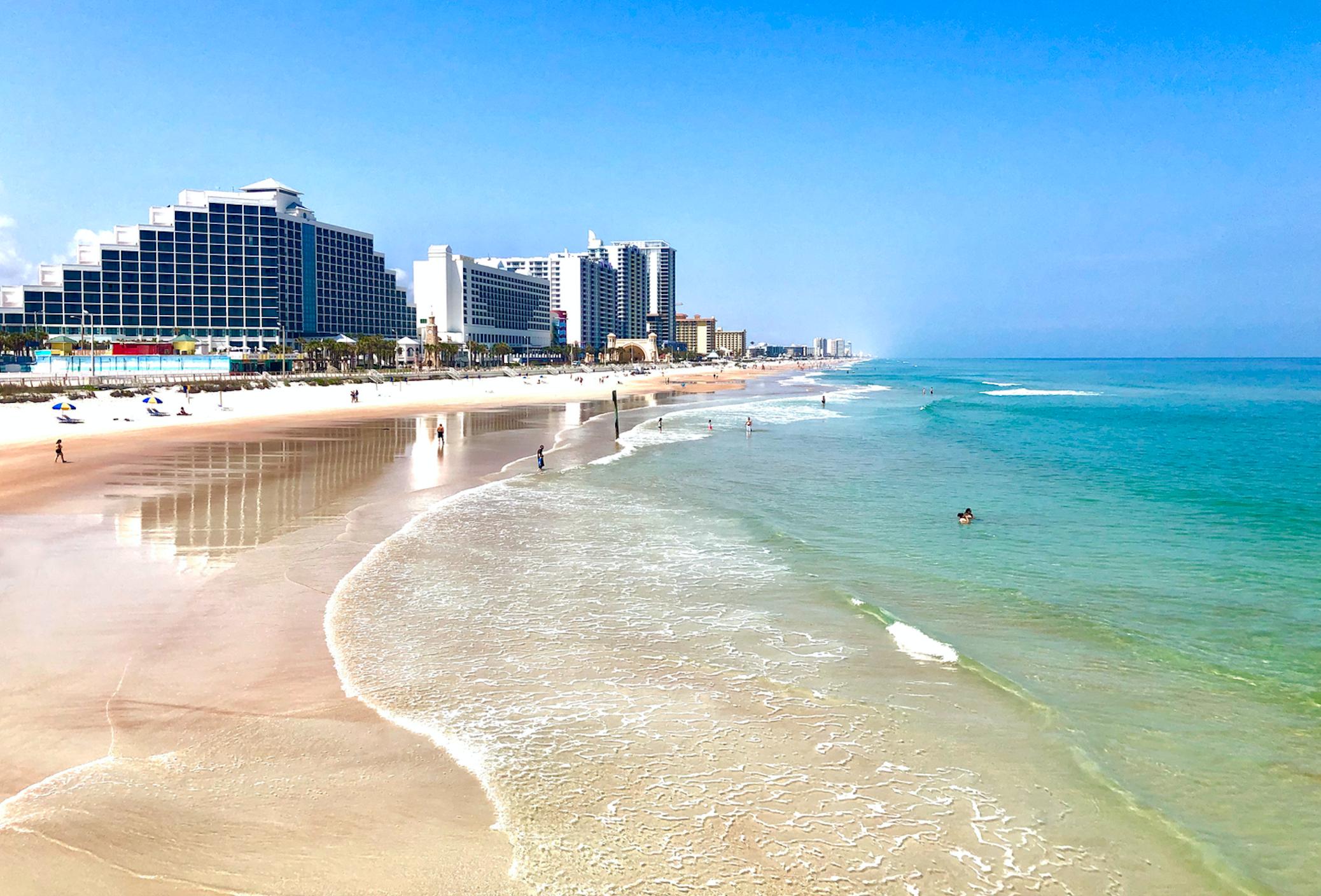 Free & cheap things to do in Daytona Beach: image of beautiful beach shoes and hotels at Daytona Beach, Florida just a short drive from Orlando