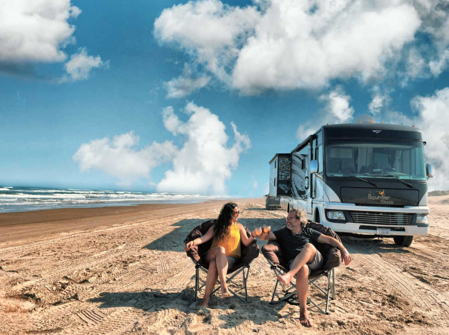 Orlando RV rentals: image of couple at the beach with their RV parked at a beach campground
